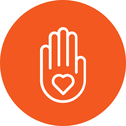 Orange circular icon of a hand with a heart inside of it.