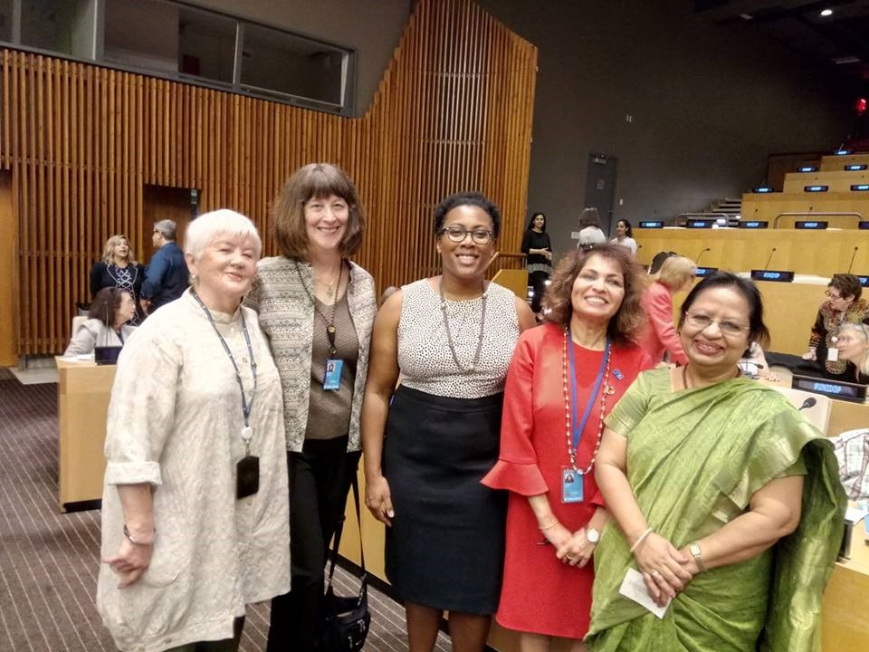 Ferdous poses with a group of women at the UN International Day of Older Persons session