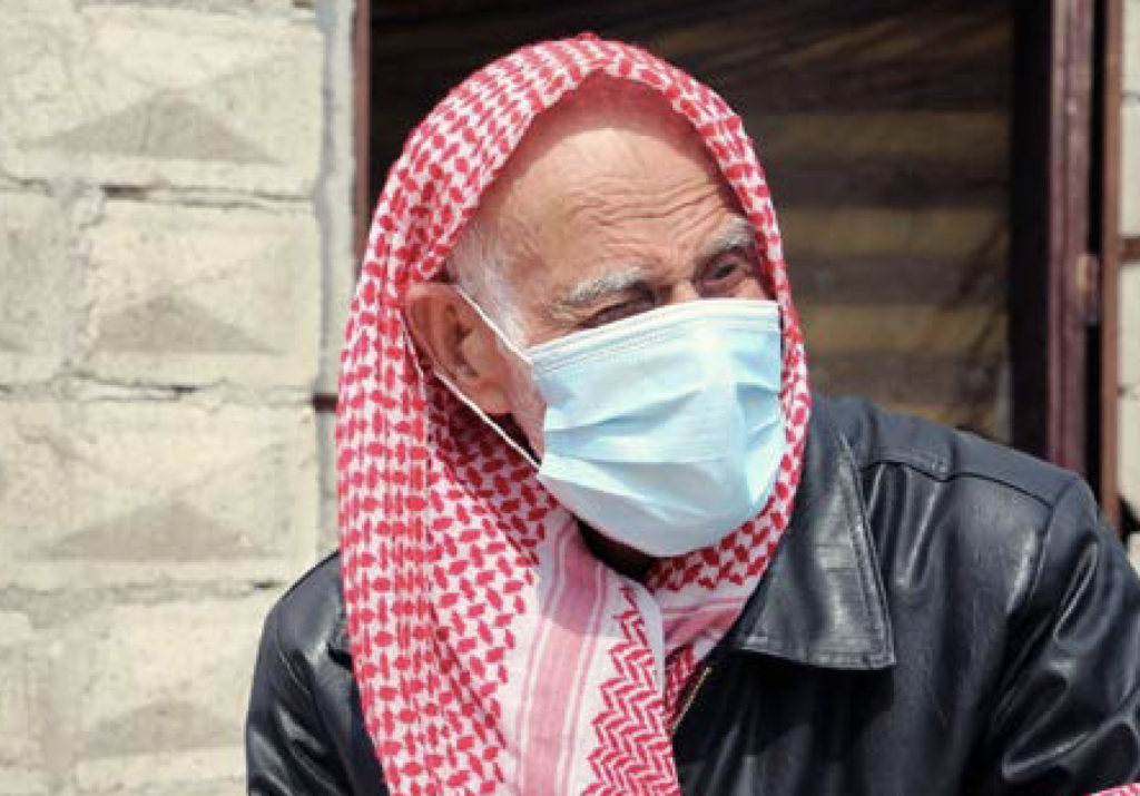 Syrian man with facial mask protecting him from COVID-19